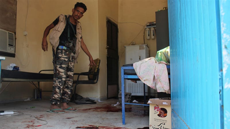 A man inspects the elderly care home after it was attacked by gunmen in Aden on Friday [Wael Qubady/AP]