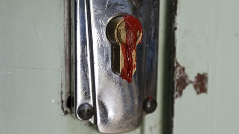 Wax covers the keyhole at the main entrance of the Muslim Brotherhood's office in Amman [Muhammad Hamed/Reuters]