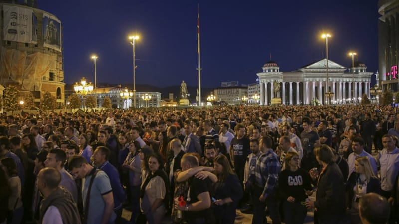 Protesters are angry with the president's decision to halt probes in a wiretapping scandal [Valdrin Xhemaj/EPA]