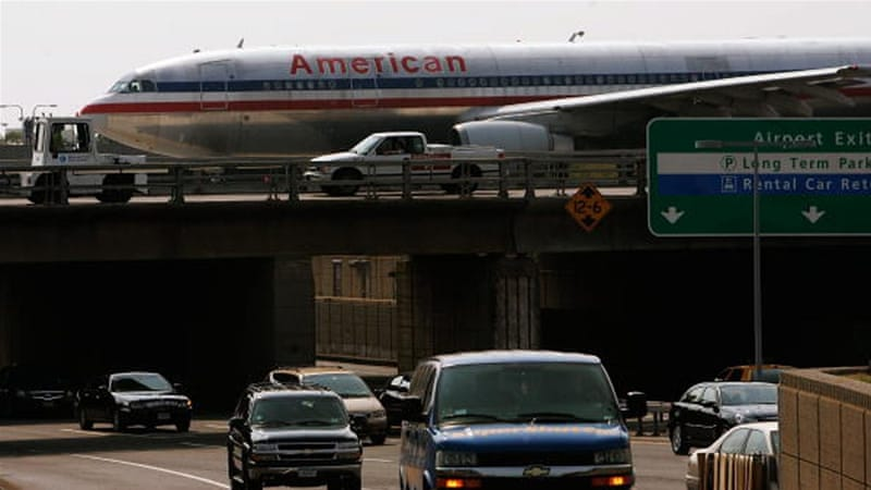 A passenger jet passes over traffic at JFK airport [Getty]