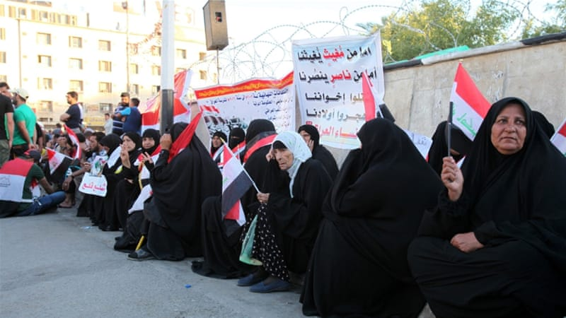Supporters of Muqtada al-Sadr carry the Iraqi national flag during a demonstration and sit-in at Tahrir Square, in central Baghdad, Iraq [EPA] [EPA]