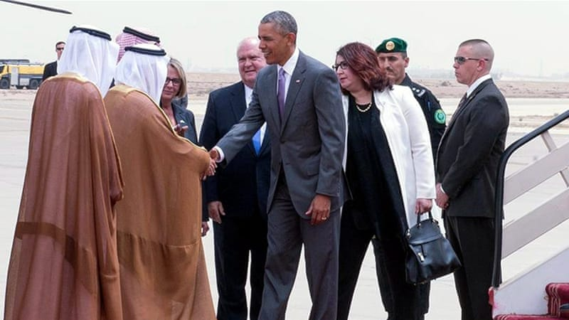 Obama being received by Prince Faisal bin Bandar bin Abdulaziz al-Saud, governor of Riyadh, at King Khalid International Airport [EPA]