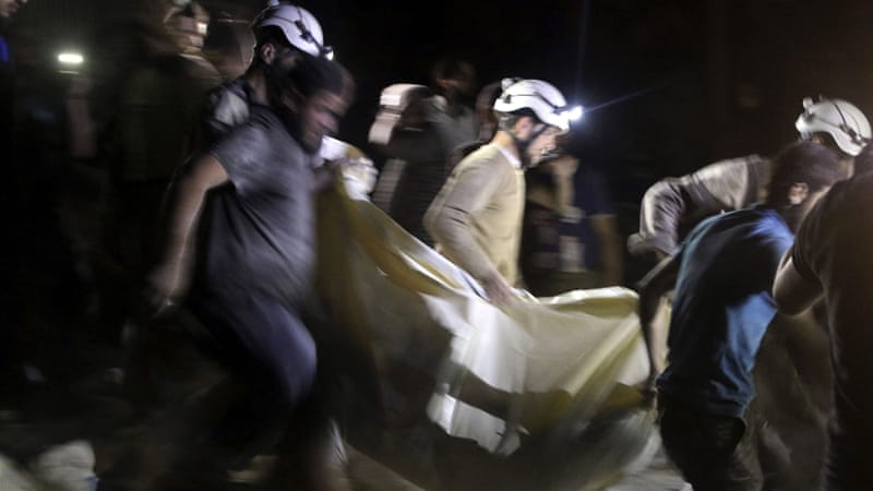Civil defence members carry a casualty after an air strike at a field hospital near Aleppo last month [Abdalrhman Ismail/Reuters]
