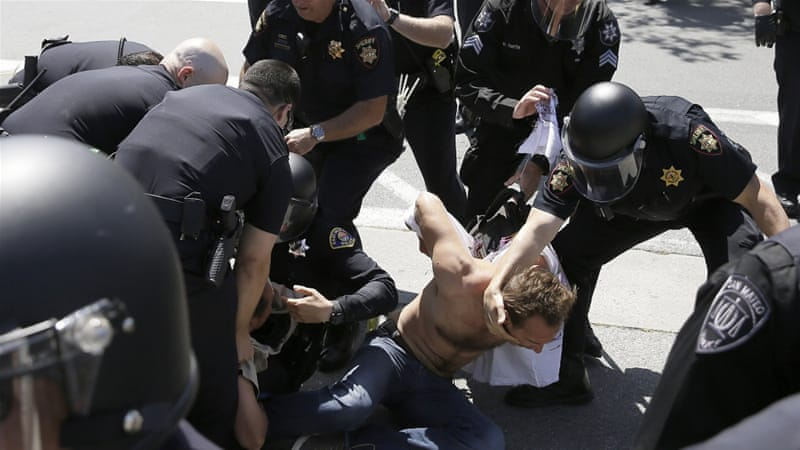 Police said five protesters were arrested on Friday [Eric Risberg/AP]