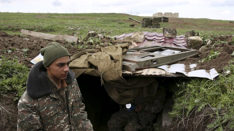 Armenian soldiers gather at their positions in Martakert province. [Reuters]