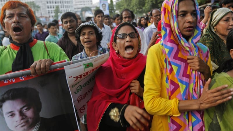 About 400 people chanted slogans including 'stop the culture of impunity' after the killing [AM Ahad/AP]
