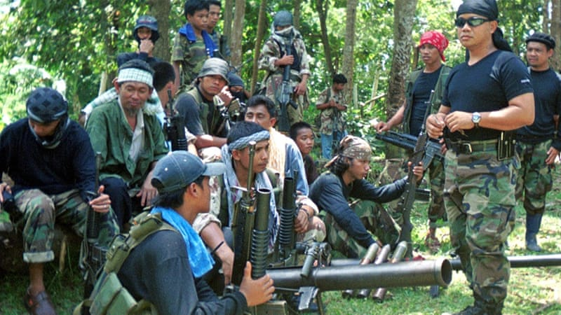 Abu Sayyaf, whose name translates as 'Bearer of the Sword', has pledged allegiance to ISIL and has been allied with al-Qaeda [File: AP]