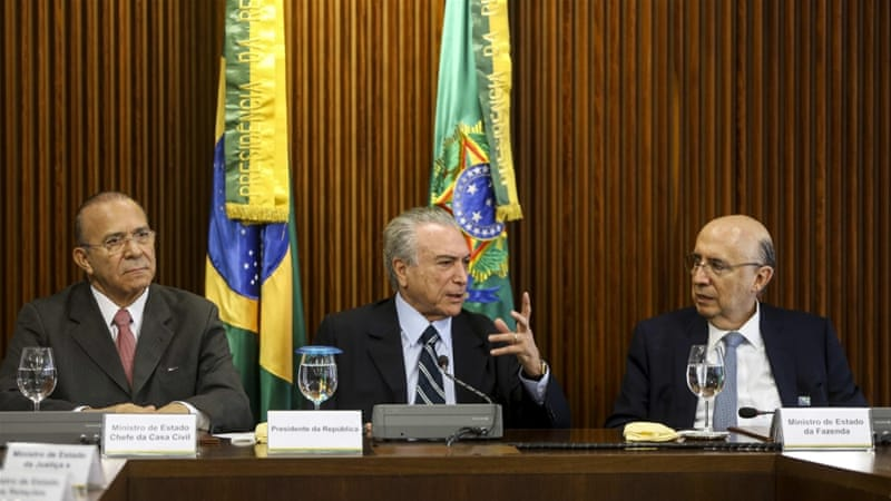 Temer (C) has been accused by Rousseff and her supporters of plans to dismantle government social programmes [EPA]