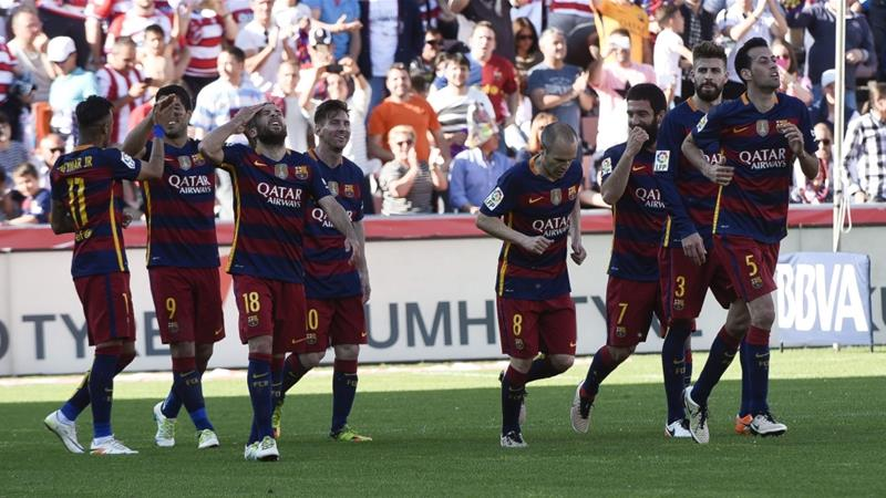 The win in Granada clinched Barcelona's eighth league title in 12 seasons [EPA]