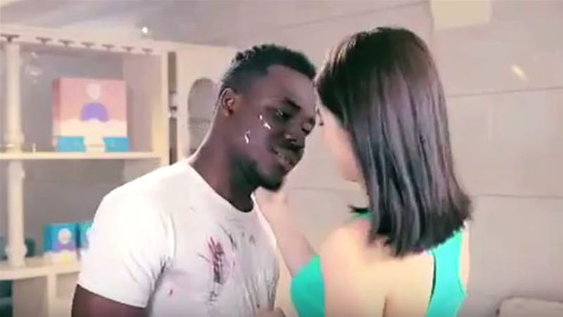 The advert shows a black man being shoved into a washing machine and turning Chinese [YouTube]