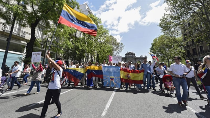 People march along Alcala Street to protest against Venezuelan President Maduro in Madrid [Fernando Villar/EPA]