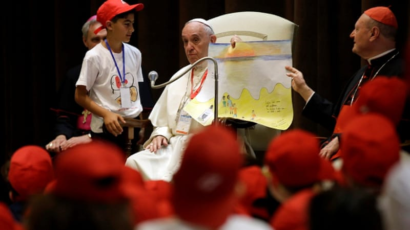 Pope Francis meets the children as rescue agencies brought thousands of refugees to shore on Saturday [Reuters]