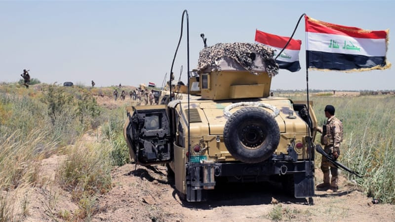 Iraqi military trucks take up position during a military operation southwest of Fallujah city [EPA]