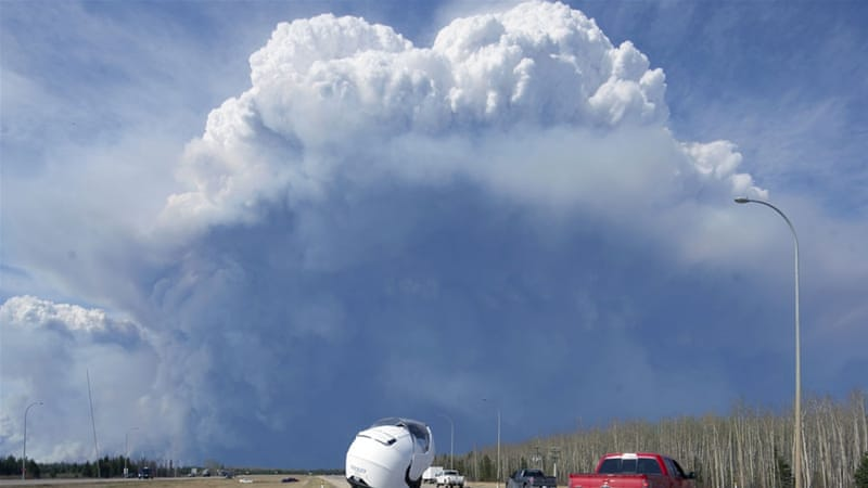 Pyrocumulus cloud building as a result of the forest fire around Fort McMurray, Alberta. As seen from Canada's highway 63 [EPA-Chris Schwarz-Govt. of Alberta] [EPA]