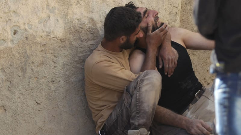 More than 250,000 people have been killed in Syria's civil war, while half the country's population is displaced [Khalil Ashawi/Reuters]