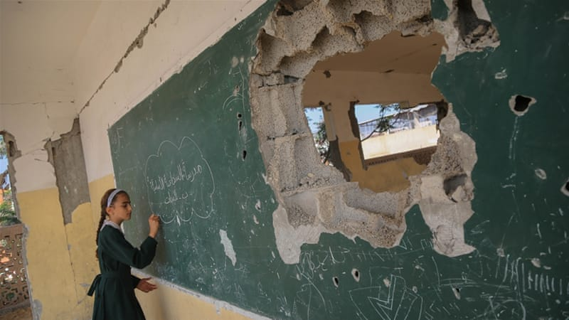 Several education facilities came under heavy Israeli shelling during the 2014 war on Gaza [Ezz Zanoun/Al Jazeera]