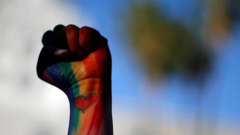 A mourner holds up her fist painted in rainbow colours at a vigil for the victims a day after the mass shooting in Orlando, Florida [REUTERS]