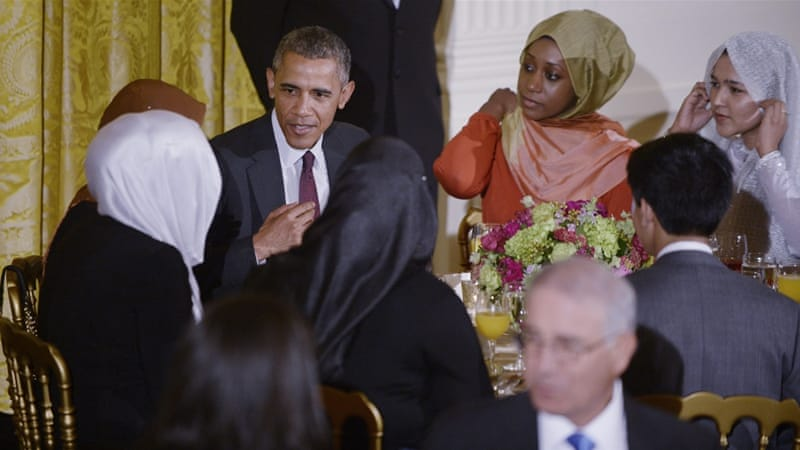 US President Barack Obama speaks with attendees at an Iftar dinner celebrating Ramadan in the White House in July 2015 [EPA]