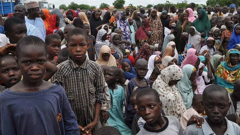 Civilians take refuge at a school in Maiduguri after fleeing a Boko Haram attack in Bama [AP file Photo/Jossy Ola]
