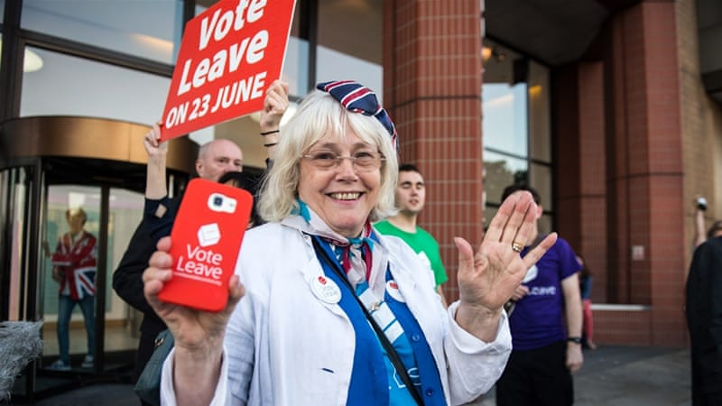 A vote Leave supporter celebrates outside Vote Leave HQ, Westminster Tower on June 24, 2016 in London [Chris J Ratcliffe/Getty Images]