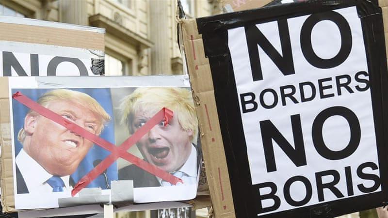 Protesters gather outside 10 Downing Street on the day David Cameron announced his resignation in London, Britain [EPA]