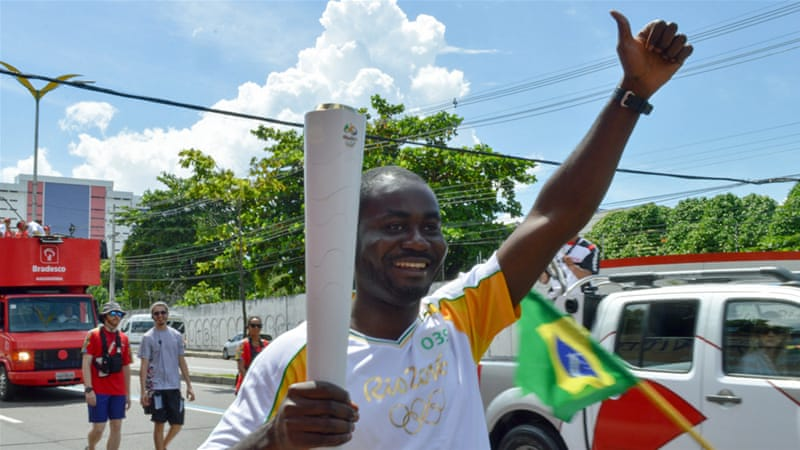 Haitian Abdias Dolce was able to carry the Olympic torch in Brazil to chants of 'Haiti' from other refugees [Donna Bowater/Al Jazeera]
