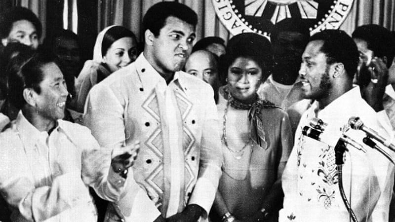 Ferdinand Marcos, left, wanted to hold the Ali-Frazier bout in the Manila to deflect attention from the political unrest [AP File Photo]