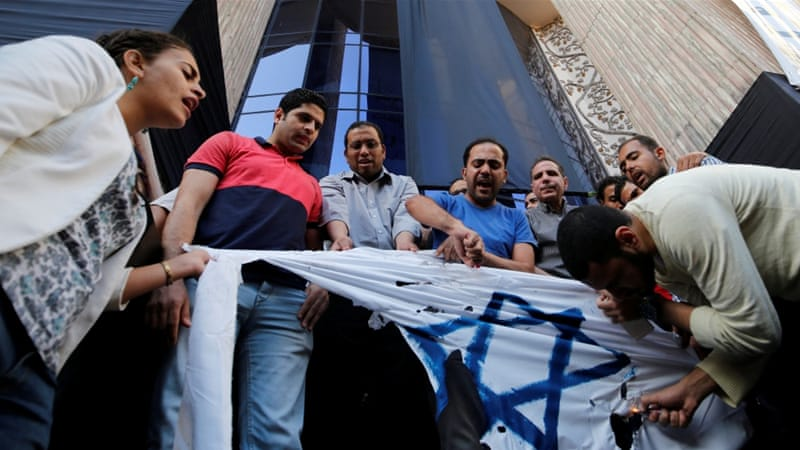Egyptian activists burn an Israeli flag in protest against a possible visit by Israeli Prime Minister Benjamin Netanyahu to Egypt [Reuters]