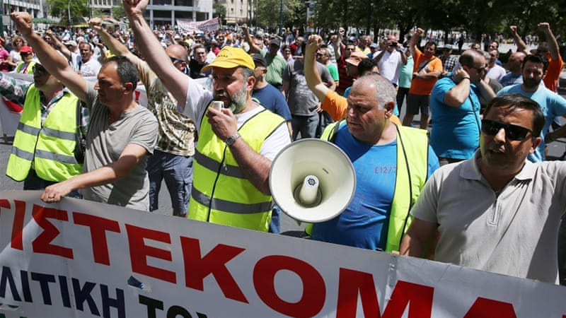 Port workers shout slogans during a demonstration against the privatisation of the ports of Piraeus and Thessaloniki, in Athens, Greece [EPA]