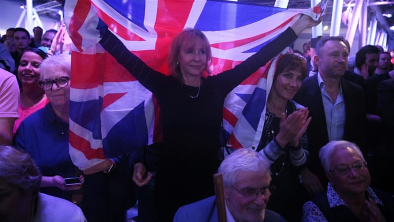A Brexit supporter holds a Union Flag at a Vote Leave rally in London, Britain June 4. [Reuters]