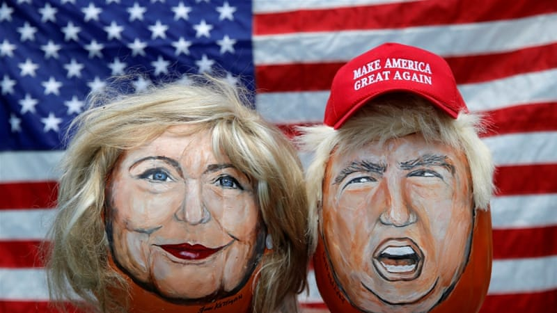 The images of Hillary Clinton and Donald Trump are seen painted on decorative pumpkins [REUTERS]