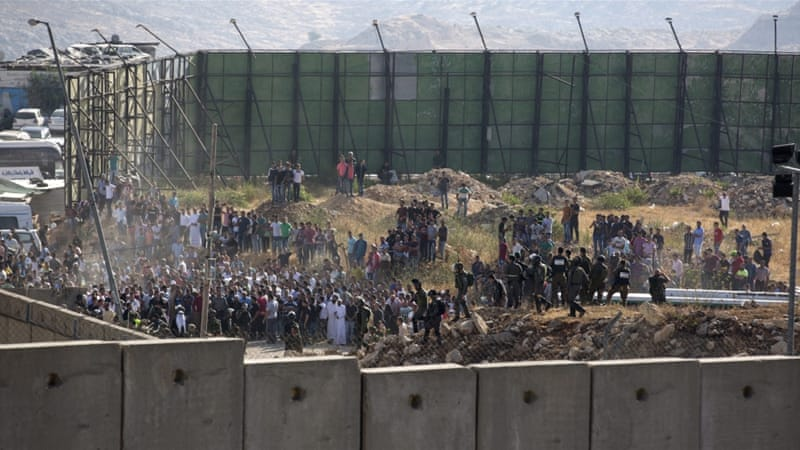 Clashes broke out at the Qalandia checkpoint in the occupied West Bank on Friday [Atef Safadi/EPA]