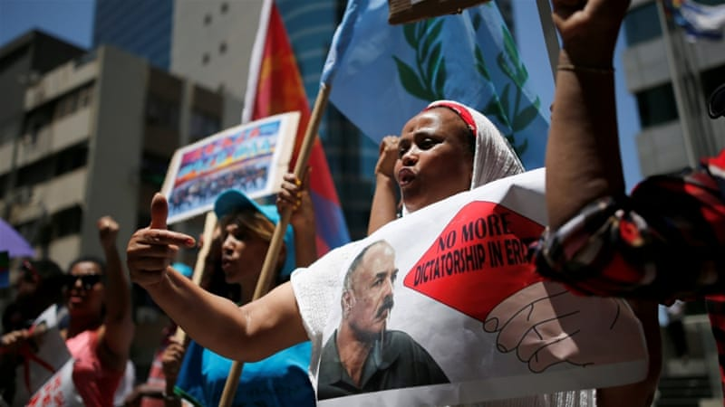 An Eritrean refugee protests against government outside EU offices in Israel [File: Amir Cohen/Reuters]
