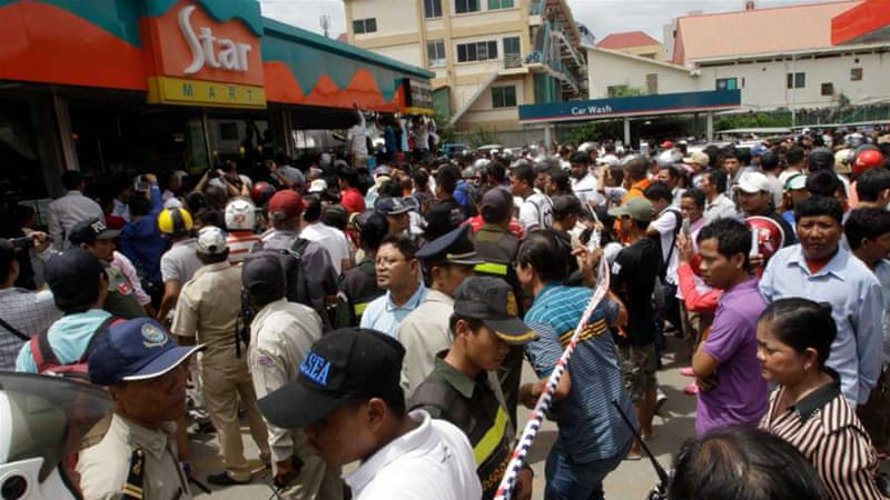 Hundreds gathered outside the store Kem Ley was killed as many of them mourned [AP]