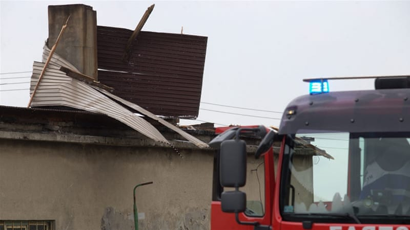 Metal sheeting blown around a chimney after a storm in Kozle Rogi village, southern Poland [Andrzej Grygiel/EPA]
