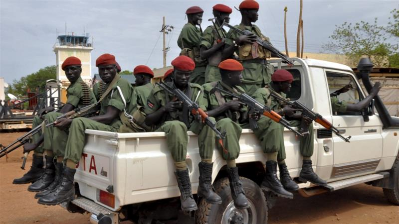 Members of the SPLM-IO forces allied with South Sudan's former rebel leader Riek Machar ride on a pick-up truck [Reuters]
