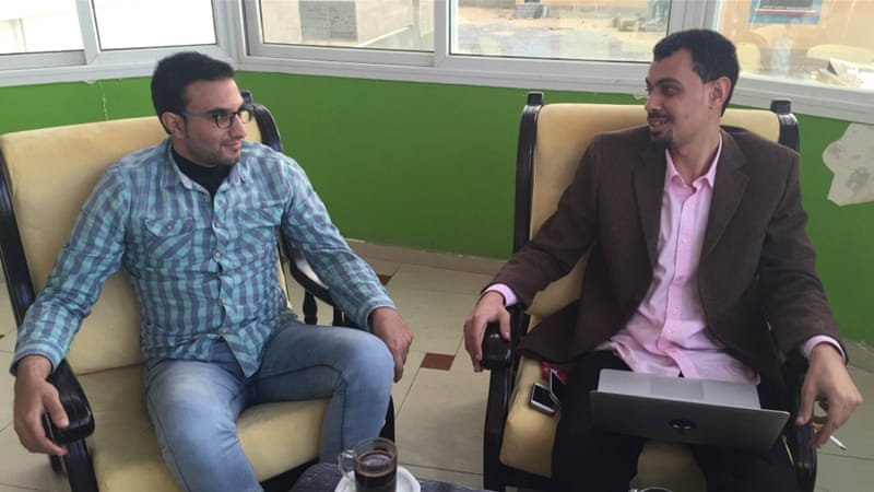 Anees al-Farra, pictured at left, and Anas Hamra say many of those who helped to make the Gaza Happy video have since moved away [Walaa Ghussein/Al Jazeera]