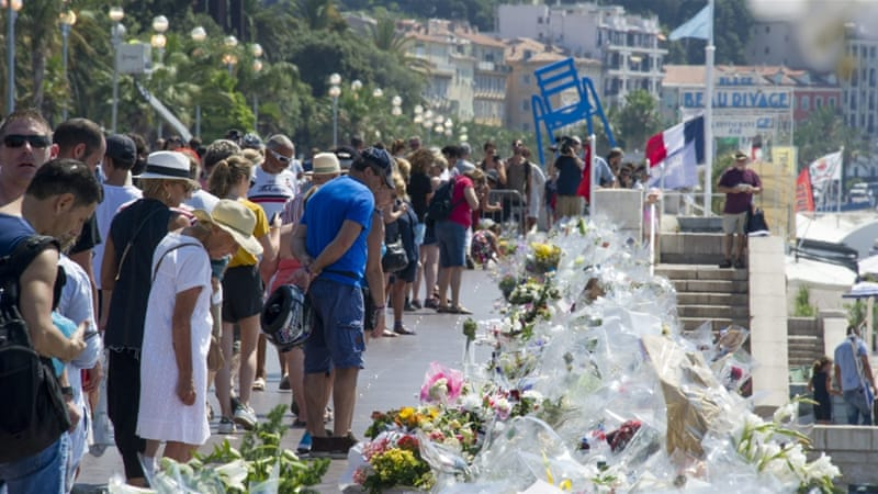 People gather at the new area for floral tributes on the Promenade des Anglais in the French riviera city of Nice, July 19 [EPA]