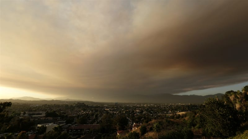 Wildfires have burned through 20,000 acres of land near Los Angeles [Nick Ut/AP]