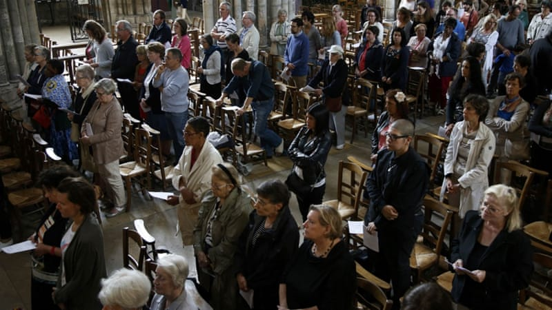 People attend Mass to pay tribute to the priest killed in the Normandy church attack [Pascal Rossignol/Reuters]
