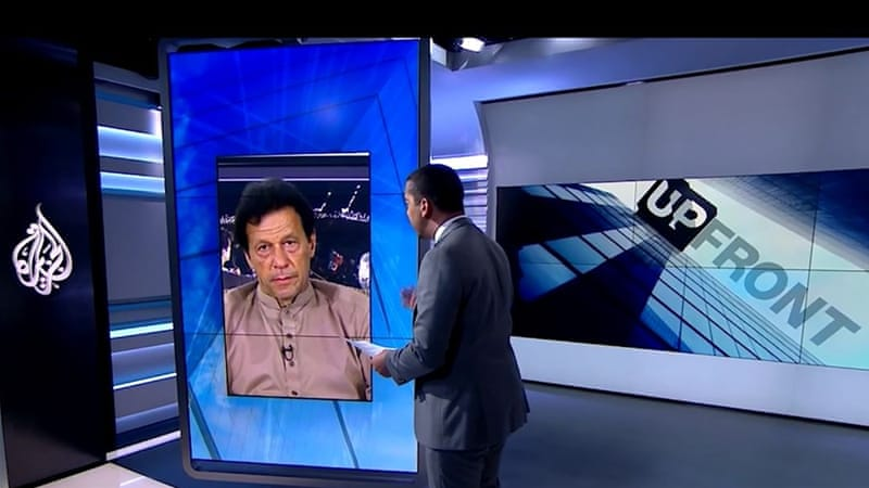Imran Khan, pictured on the screen, is a Pakistani politician and former cricket sensation [Al Jazeera]
