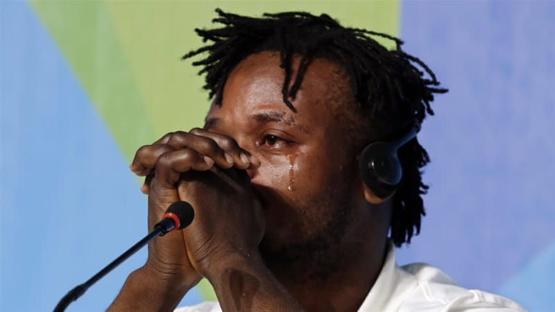 Judoka Misenga cried as he recalled being separated from his brothers [Barbara Walton/EPA]