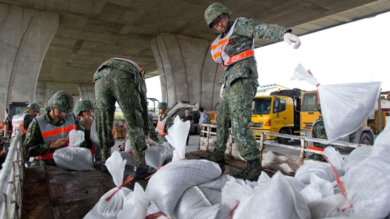 Soldiers bring sandbags to northeast Taiwan as typhoon precautions are instigated [EPA/Taiwan Military News Agency]