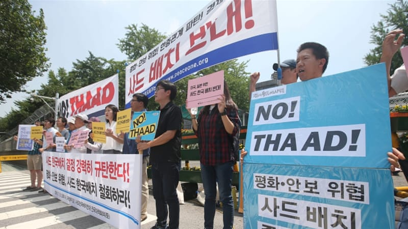 South Korean activists have taken to the streets to protest against the missile system [EPA]