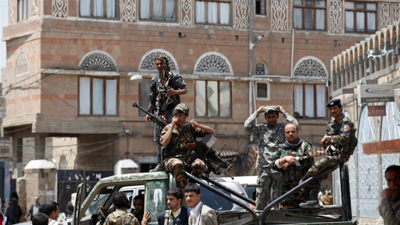 Forces loyal to ousted president Ali Abdullah Saleh stand on the back of a police truck outside Yemen's parliament during a session convened for the first time since a civil war began almost two years ago [Reuters]