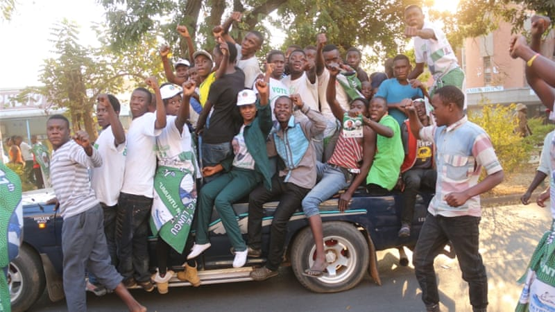 Supporters of Edgar Lungu celebrated in the streets after he narrowly won re-election [Jean Serge/Reuters]