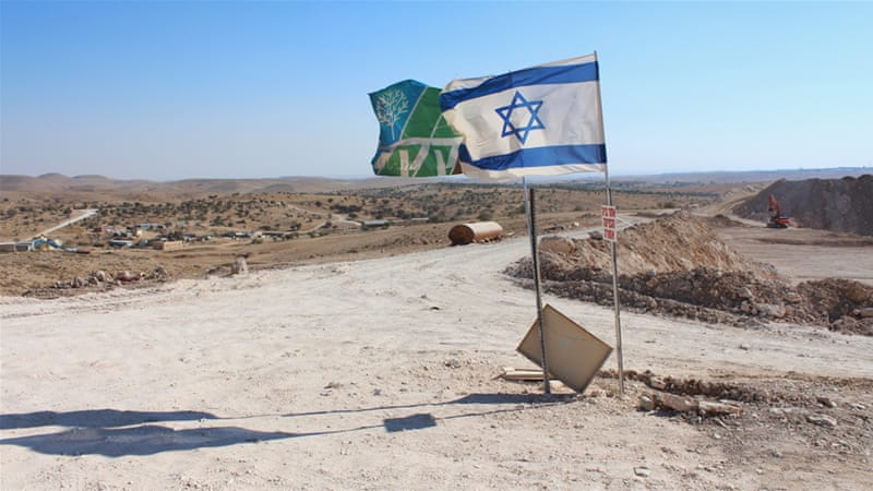 Israeli and KKL-JNF flags sit atop the work camp for the planned town of Hiran [Mary Pelletier/Al Jazeera]