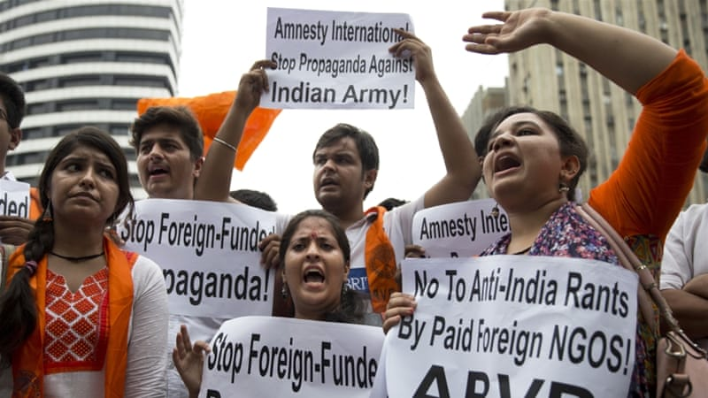Supporters of ABVP shout slogans against Amnesty International India for its alleged anti-India stands [Tsering Topgyal/ AP]