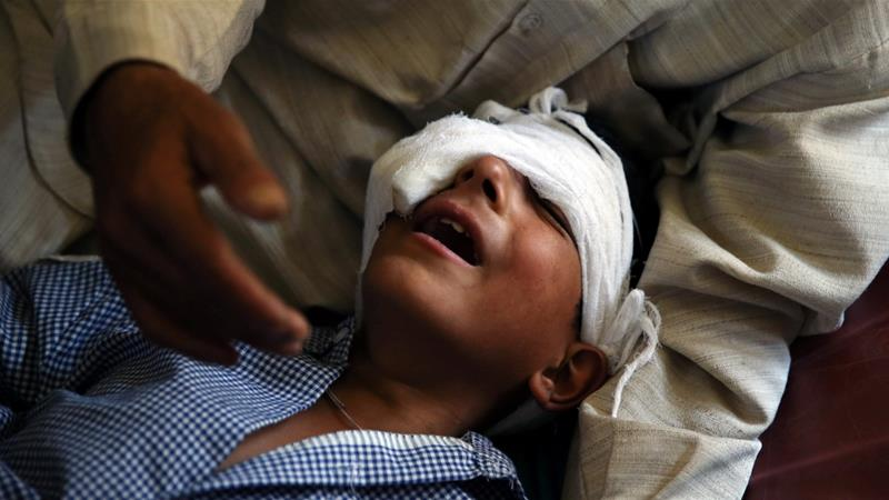 A father comforts his son who, he said, was injured by pellets shot by security forces in Srinagar following weeks of violence in Kashmir on August 18, 2016 [File Photo: Cathal McNaughton/Reuters]