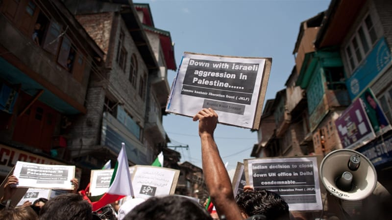 Kashmiri activists hold placards during a protest against Israel's military operation in Gaza on July 11, 2014, in Srinagar [Getty]